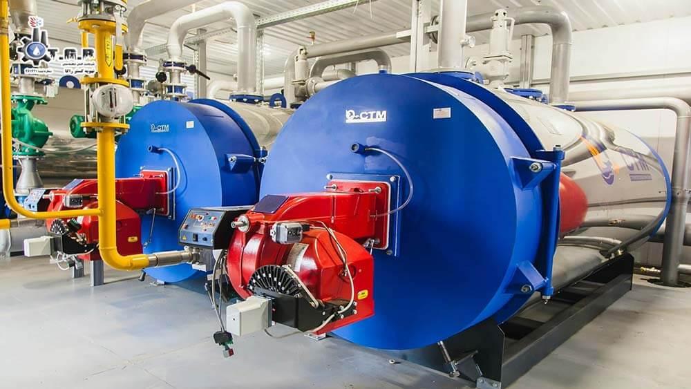 تصویری از دیگ های بزرگ آبی رنگ که در هوشمند سازی موتور خانه ها کاربرد دارد